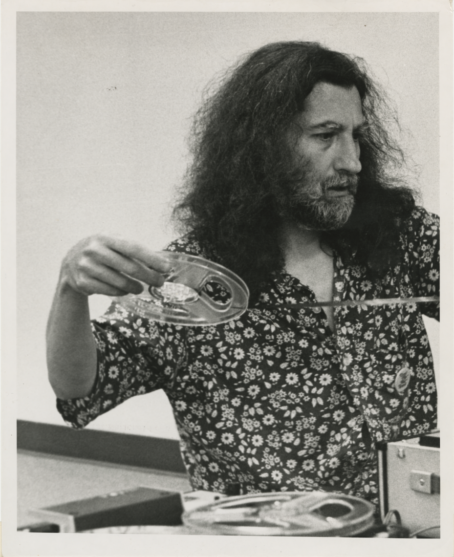 Working on a tape collage at Thomas Jefferson College's first National Poetry Festival, 1971. Grand Valley State College. Photographer unknown. Reproduced courtesy of the Estate of Jackson Mac Low and Anne Tardos.